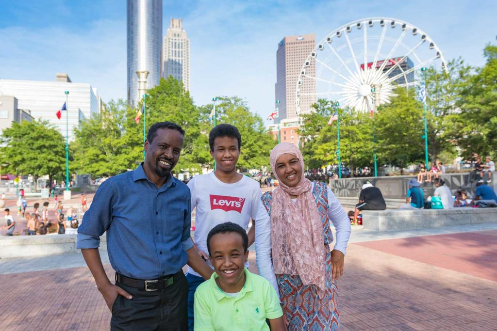 The Adam family in front of the Atlanta ferris wheel