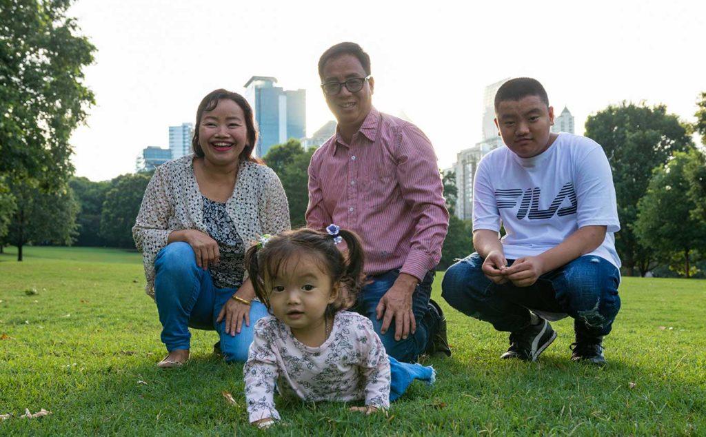 The Karna Dhoj Rai family in a park