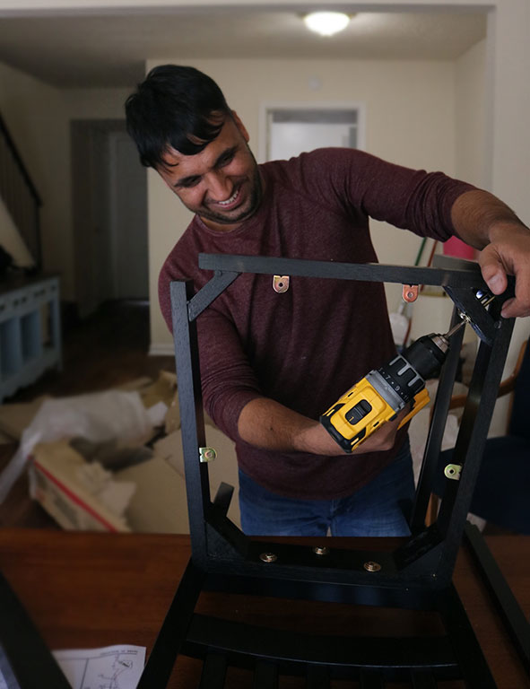 Man volunteering to help build furniture