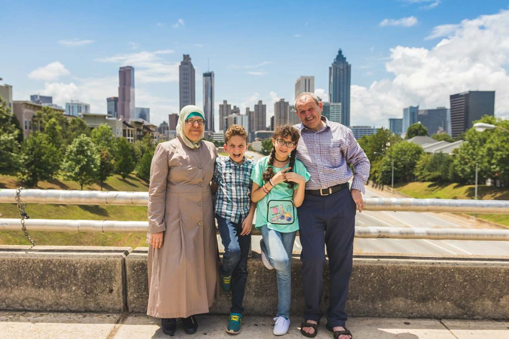 The Bassout family in front of the Atlanta skyline